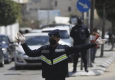 شرطي مرور في غزة يرتدي الكمامة - توضيحية