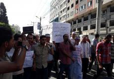 خريجو غزة يعتصمون أمام وزارة العمل للمطالبة بحل قضيتهم -صورة ارشيفية-