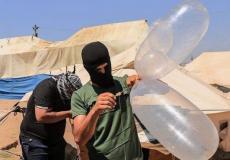 بالونات حارقة تبعد عن غزة 40 كيلو متر