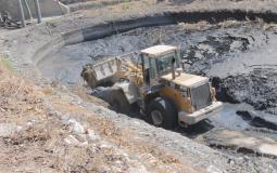 أعمال تنظيف بركة تجميع مياه الشيخ رضوان