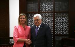 الرئيس محمود عباس وفيدريكا موغريني