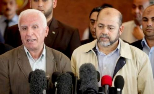عزام الأحمد وموسى أبو مرزوق