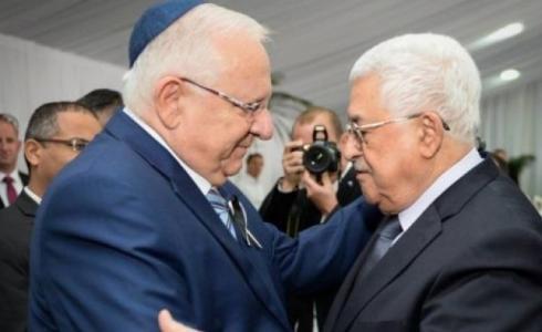 الرئيس الفلسطيني محمود عباس والإسرائيلي رؤوفين ريفلين -ارشيف-