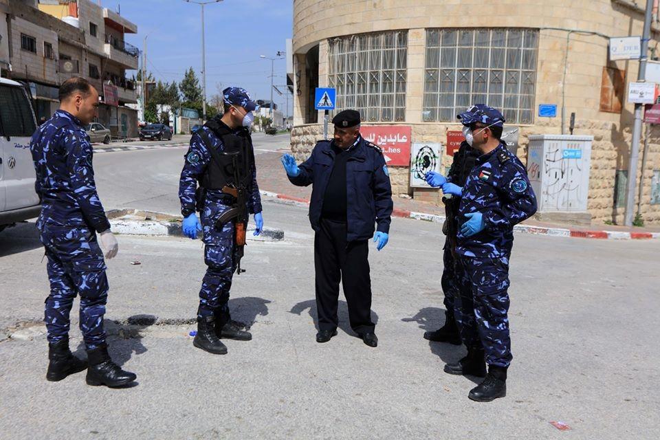 الشرطة الفلسطينية فيروس كورونا.jpg